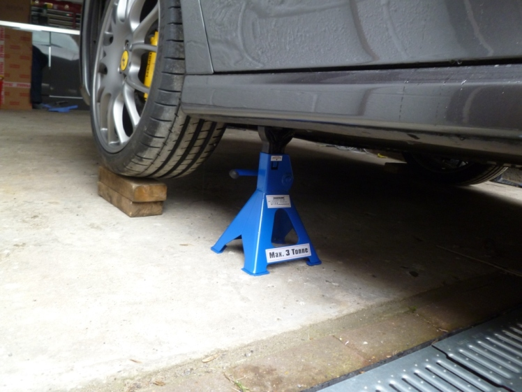 Axle stand at front of car