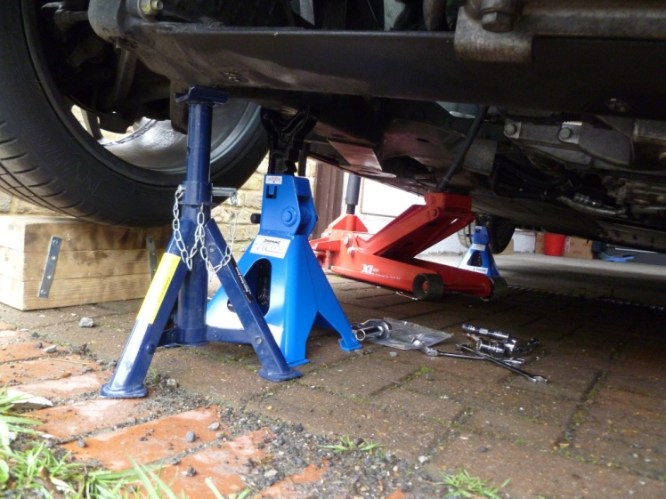 Axle stands at rear of car